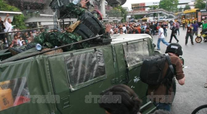 Anti coup protesters chase away soldiers